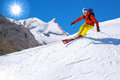 Skier skiing downhill in high mountains, Matterhorn, Switzerland Royalty Free Stock Photo
