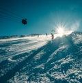 Skier slides down on the snow slope