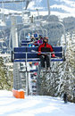 Skiers in chairlift Royalty Free Stock Photo