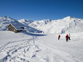 Skiers on a ski slope picturesque chalet the alps france Royalty Free Stock Photos
