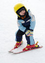 Skiing child learning to ski in winter resort practicing the correct moves Stock Photo