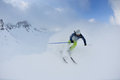 Skiing on fresh snow at winter season Royalty Free Stock Image