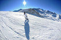 Skiing on fresh snow at winter season at sunny day Royalty Free Stock Photos