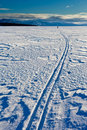 .Skiing person on frozen lake Royalty Free Stock Images