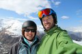 Skiing selfie couple winter ski vacation in french alps Stock Photos