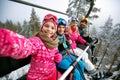 Skiing, ski lift, ski resort - happy family skiers on ski lift m Royalty Free Stock Photo