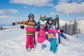 Skiing winter fun happy family snow sun and enjoying vacations Stock Photo