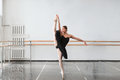 Skill ballet dancer shows stretching in class