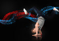 Skilled male dancer balancing on his forearms against blue and red digital swirl black background Stock Photography