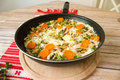 Skillet with rice with chicken and vegetables Royalty Free Stock Photo