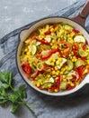 Skillet vegetarian vegetable fajitas on the gray table Royalty Free Stock Photo