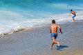 Skim Boarder preparing to ride a shore break wave at Aliso Beach in Laguna Beach, California. Royalty Free Stock Photo