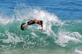 Skim boarder riding wave at brooks street beach l image shows a a shore break laguna california Royalty Free Stock Images