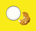 Skim milk with bitten cookie top view of a glass of a partially eaten on a bright yellow background Stock Photo