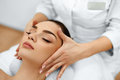 Skin, Body Care. Woman Getting Beauty Spa Face Massage. Treatment. Royalty Free Stock Photo