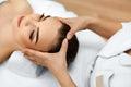 Skin, Body Care. Woman Getting Beauty Spa Face Massage. Treatmen Royalty Free Stock Photo