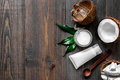 Skin care. Coconut cream and lotion on wooden table background top view copyspace