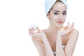 Skin care lady putting face cream. Royalty Free Stock Photo