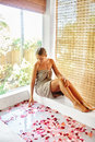Skin Care Spa Treatment. Woman On Bathtub. Flower Rose Bath. Royalty Free Stock Photo