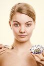 Skin care woman applying clay mask on face spa young with brush her girl taking of her dry compexion and beauty treatment Royalty Free Stock Photo