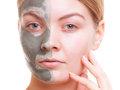 Skin care woman applying clay mask on face spa young her girl taking of her dry compexion isolated and beauty treatment Royalty Free Stock Photography