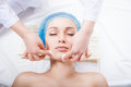 Skin care woman cleaning face by beautician women over white background Royalty Free Stock Images