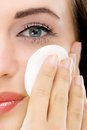 Skin care woman removing makeup close up face with cotton swab pad Stock Image