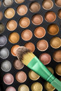 Skin color shade of eye shadow with green brush Royalty Free Stock Photo