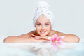 Skincare beautiful young woman in white towel on her head with reflection in water Stock Photo