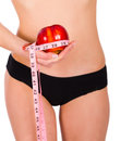 Skinny body thank to healthy nutrition girl with beautiful holding an apple tied with measure tape showing the way a healthier Royalty Free Stock Photography