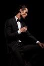 Skinny man in black with bowtie posing in dark studio Royalty Free Stock Photo