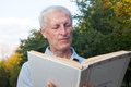 Skinny  old man reading book Royalty Free Stock Photo