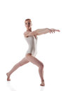 Skinny redhead gymnast posing in white leotard isolated on background Royalty Free Stock Photo