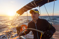 Skipper drives the sailing boat in the Aegean sea. Sport. Royalty Free Stock Photo