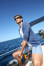 Skipper navigating boat Royalty Free Stock Photo