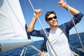 Skipper standing on y sailing boat sailboat while Royalty Free Stock Photos