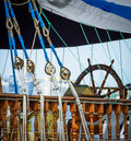 Skipper wheel on sailboard steering sea ropes and nautical equipment wooden yacht ship s deck exterior with tackles control bridge Stock Photography