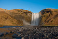 The skogafoss waterfall in iceland a nice sunny day near Royalty Free Stock Photography