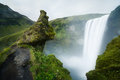 Skogafoss waterfall in iceland surrounded by green nature Royalty Free Stock Photos