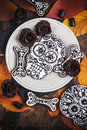 Skull cookies with liquorice flowers for halloween homemade Stock Images