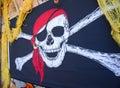 Skull and cross bone decorative flag. Royalty Free Stock Photo