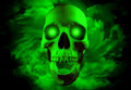 Skull with glowing eyes on spiral clouds background Royalty Free Stock Photo
