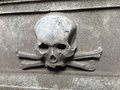 Skull at gravestone and bones an ancient Stock Photos