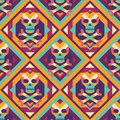 Skull and heart on colored geometric background - seamless vector pattern. Abstract geometric seamless vector background.