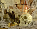 Skull with magic letter human paper scroll quill and sand glasses in tomb background Stock Images