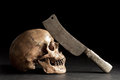 Skull with old knife still life photography human on his forehead Royalty Free Stock Photos