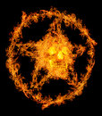 Skull in orange flame pentagram isolated on black background Stock Photography