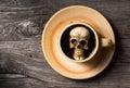 Skull soak in coffee Royalty Free Stock Photo