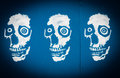 Skull trio graffiti art on blue background Royalty Free Stock Photos