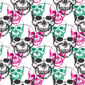 Skulls print. Skull pattern in black, pink and green color. Seamless skulls with color triangle for textile, fabric, wrapping. Vec Royalty Free Stock Photo